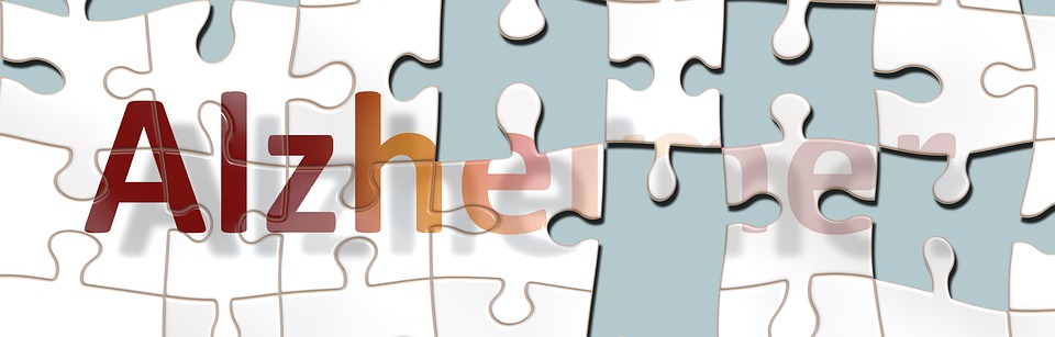 early signs of dementia - a puzzle that forms the word alzheimer's